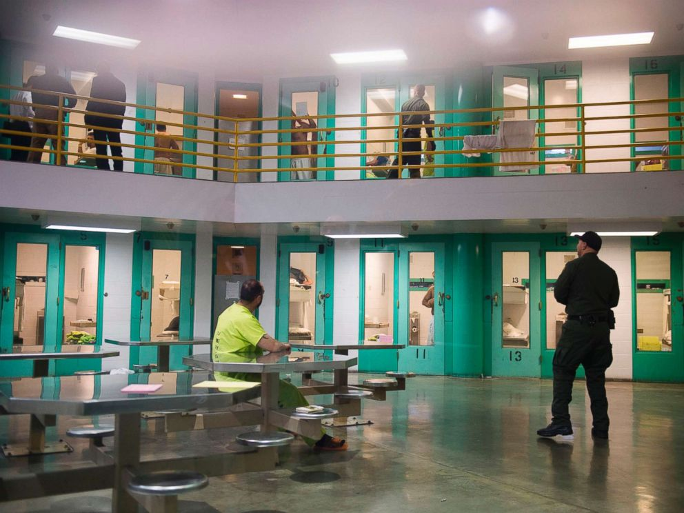 PHOTO: A sheriffs deputy (R) talks to an immigration detainee (L) in a high security housing unit at the Theo Lacy Facility on March 14, 2017, in Orange, Calif.