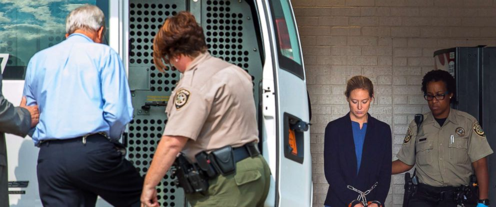 PHOTO: Molly Martens Corbett and her father Thomas Martens are loaded into a prisoner transport van at the Davidson County Courthouse in Lexington, N.C., Aug. 9th, 2017.