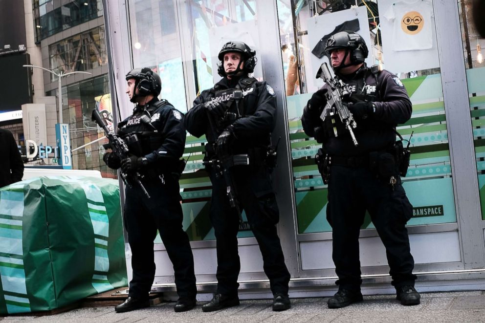 PHOTO: New York City police stand on a corner in Times Square, Dec. 12, 2017, in New York City.