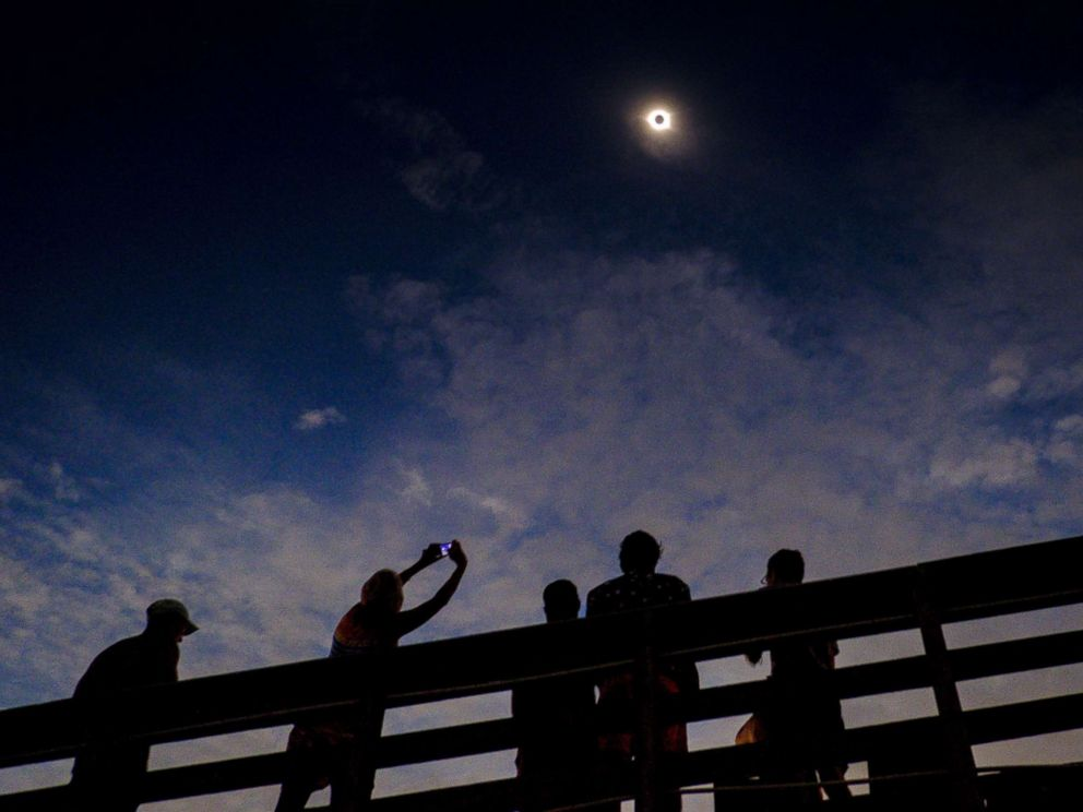 PHOTO: Solar eclipse watchers were ecstatic as the clouds broke minutes before totality during the total solar eclipse, Aug. 21, 2017, in Isle of Palms, S.C.