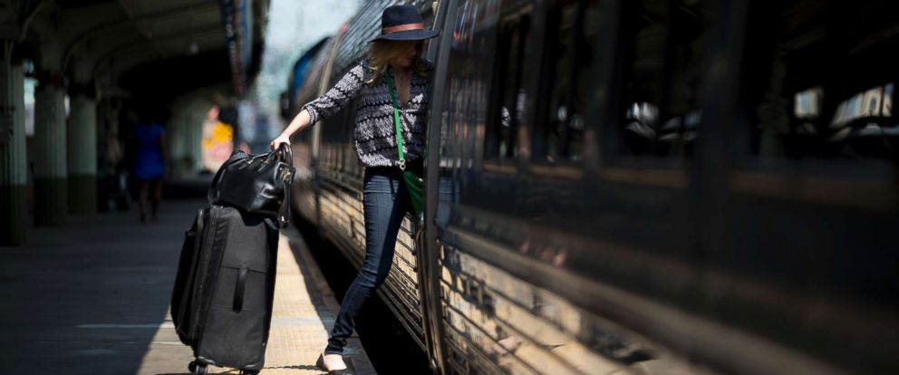 PHOTO: A passenger boards an Amtrak Northeast Regional train at Union Station in Washington, D.C., Sept. 3, 2015.