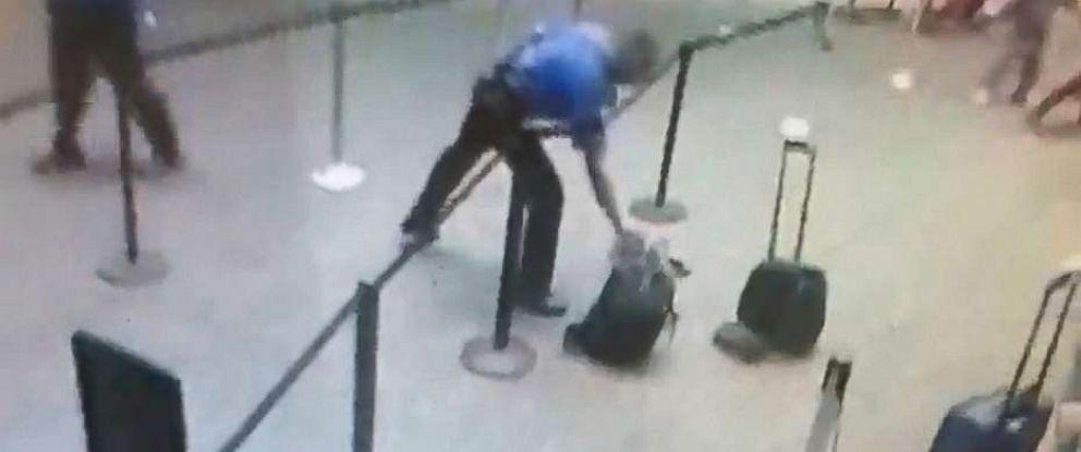 PHOTO: A TSA officer grabs a smoking bag at the Orlando International Airport in Orlando, Fla., Nov. 10, 2017.