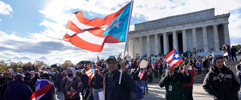 PHOTO: Members of the Hispanic Federation participate in the Unity March to highlight the ongoing humanitarian and natural disaster crisis in Puerto Rico, at the Lincoln Memorial in Washington, D.C., Nov. 19, 2017.