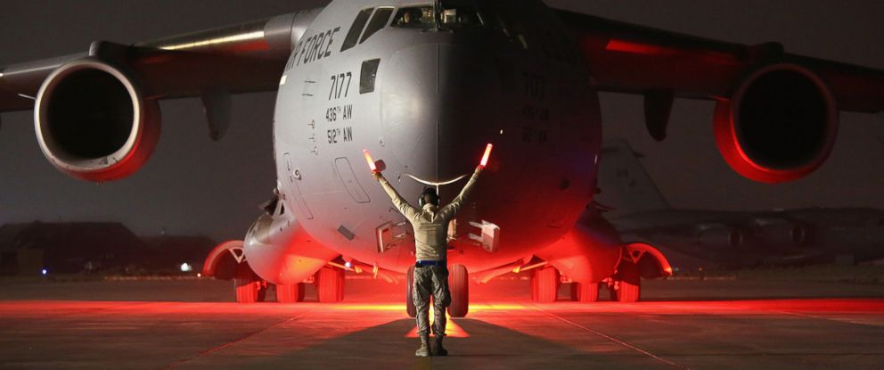 PHOTO: An airman guides a U.S. Air Force C-17 Globemaster after it returned from delivering cargo to Baghdad, Jan. 9, 2016 to a base in an undisclosed location in the Persian Gulf Region.