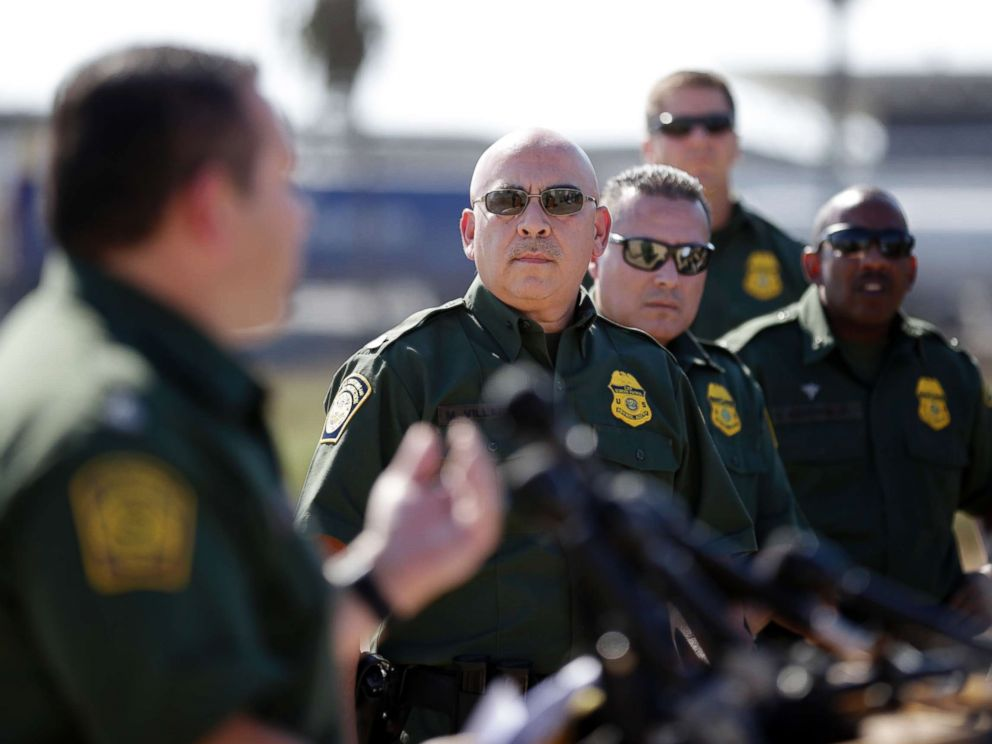 PHOTO: Roy Villarreal, Border Patrol Chief Patrol Agent, San Diego Sector, on the left, talks to other Border Patrol agents in front of secondary fences along the border that separates San Diego from Tijuana , Mexico, September 26. 2017, in San Diego.