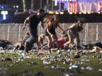 PHOTO: People run from the Route 91 Harvest country music festival, Oct. 1, 2017, in Las Vegas.