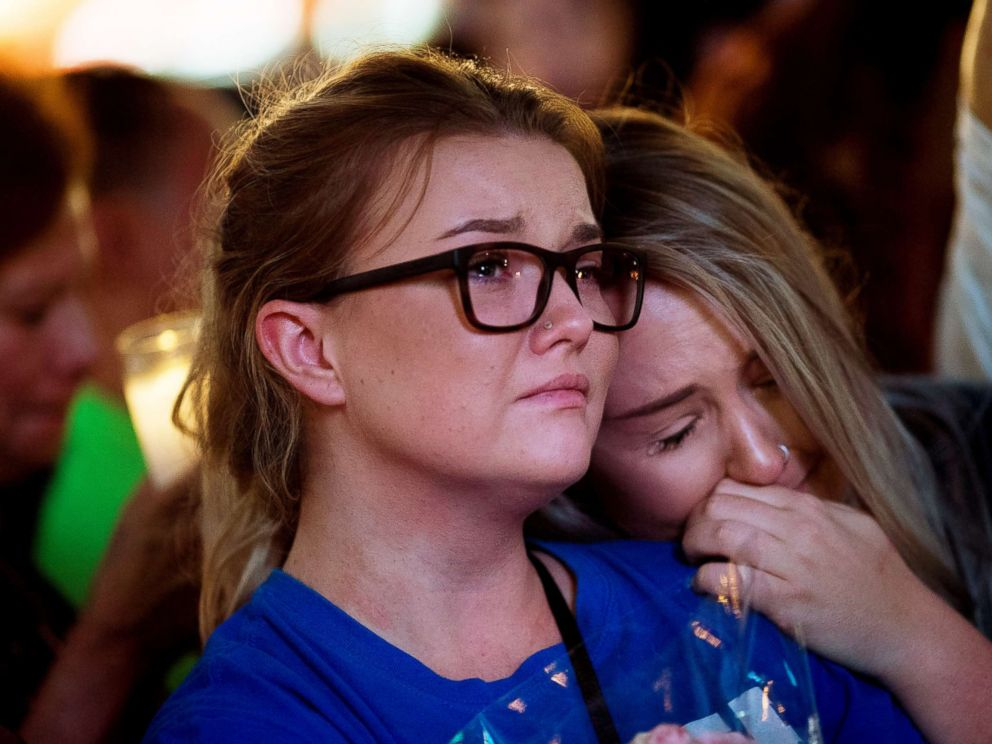 PHOTO: Mourners attend a vigil to mark one week since the mass shooting at the Route 91 Harvest country music festival, on the corner of Sahara Avenue and Las Vegas Boulevard at the north end of the Las Vegas Strip, Oct. 8, 2017, in Las Vegas.