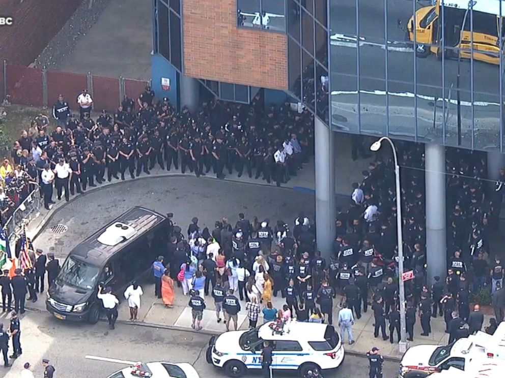 PHOTO: Hundreds of NYPD officers line the hospital exit, Aug. 11, 2017.
