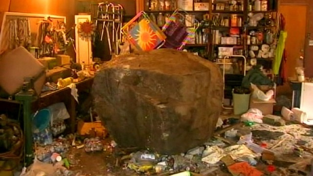 VIDEO: Large rock, loosened from hillside by a storm, landed in womans garage.