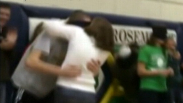 VIDEO: Blindfolded students in Minnesota were kissed by their parents at school event.
