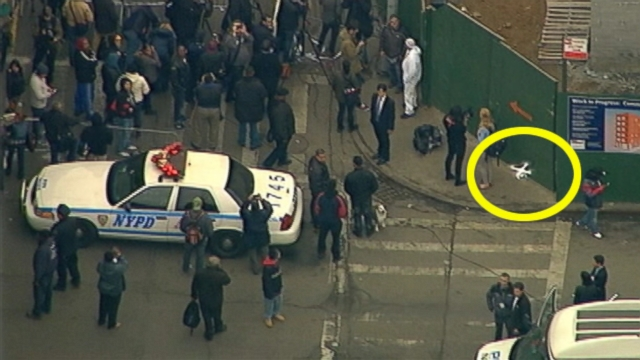 VIDEO: A drone flew above NYPD officers and onlookers gathered in East Harlem.