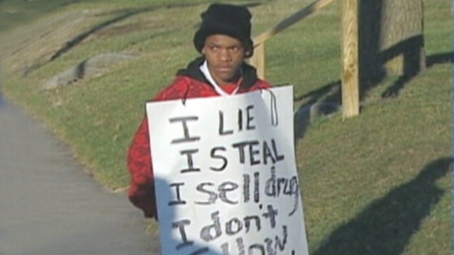 VIDEO: Indiana mother forces 14-year-old son to wear a sign detailing his crimes.