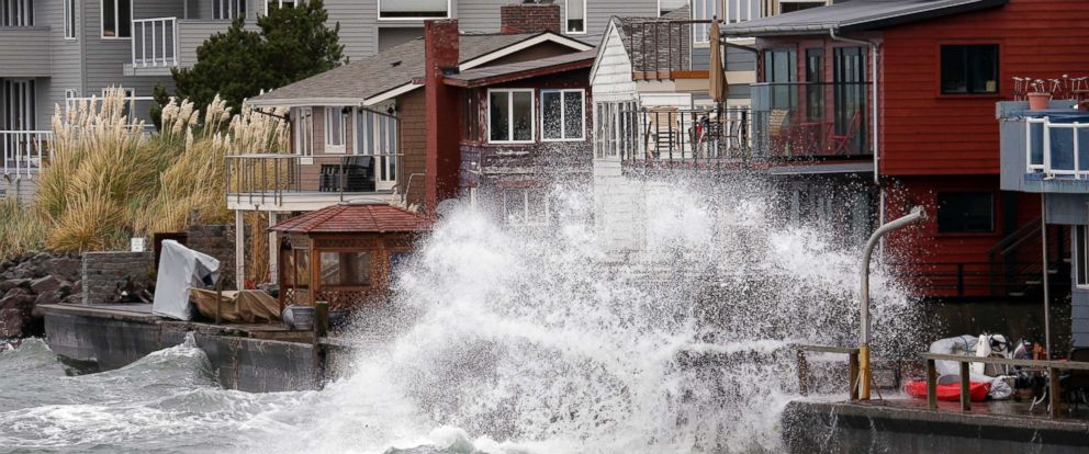PHOTO: Waves hitting a breakwater sends salt spray onto homes along Puget Sound in a windstorm, Nov. 13, 2017, in Seattle.