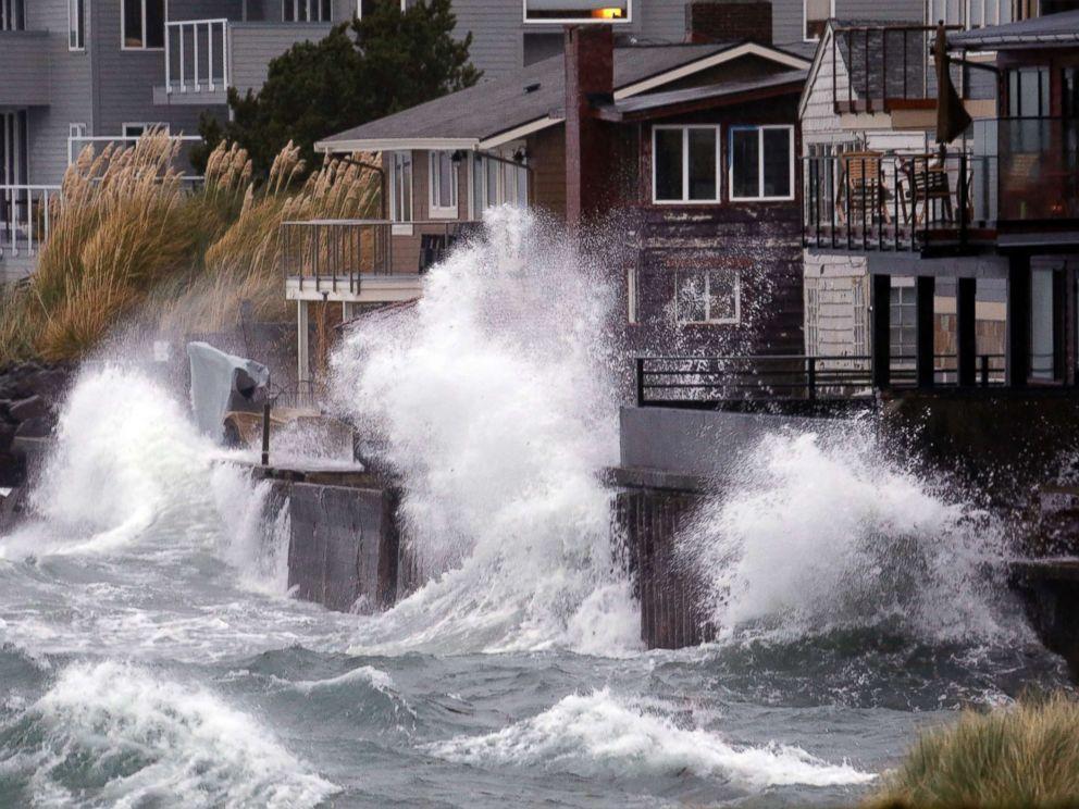 PHOTO: Waves send salt spray onto homes along Puget Sound in a windstorm, Nov. 13, 2017, in Seattle.