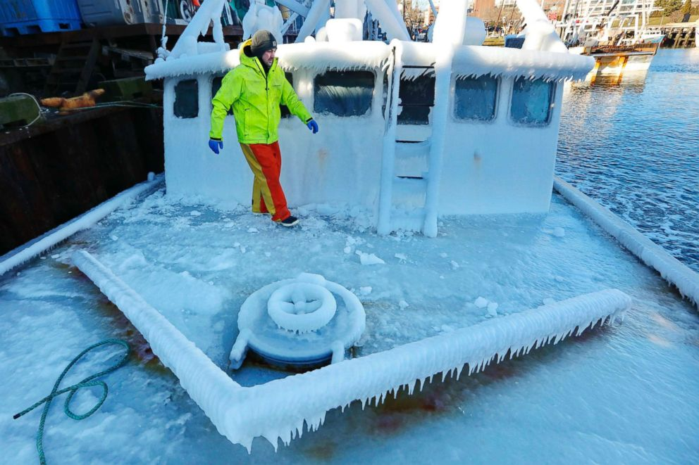 PHOTO: With temperatures in the single digits, Ray Levesque, mate of the crab/lobster boat Bradbill, makes his way across the ice-covered deck in New Bedford, Mass., Dec. 28, 2017.