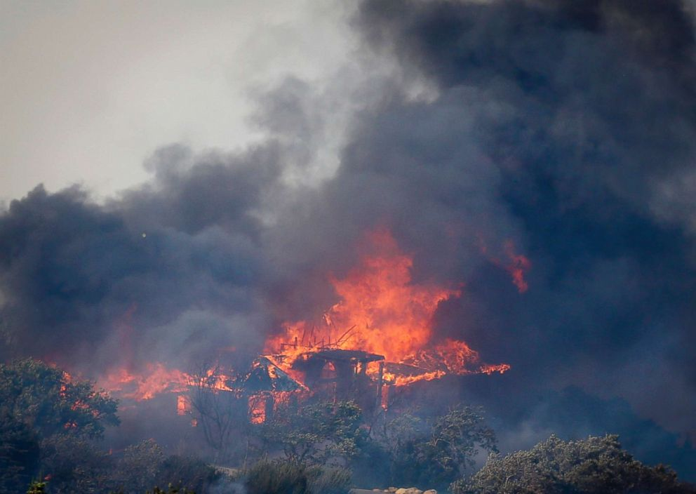PHOTO: A structure goes up in flames as a wildfire burns near the mouth of Weber Canyon near Ogden, Utah, Sept. 5, 2017.