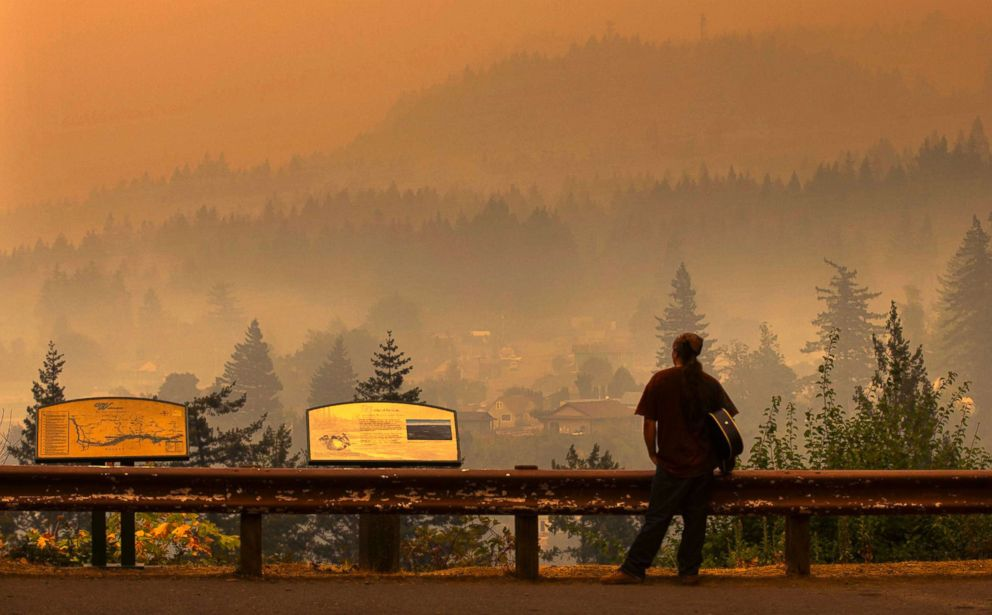 PHOTO: Jason Wheeler looks out across the Columbia River at the smoky community of Cascade Locks, Ore. on Sept. 5, 2017, after being evacuated from his home.