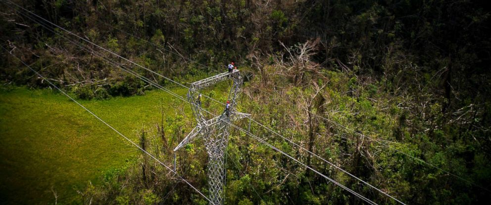 PHOTO: Whitefish Energy Holdings workers stand on towers to restore lines damaged by Hurricane Maria in Barceloneta, Puerto Rico, Oct. 15, 2017.