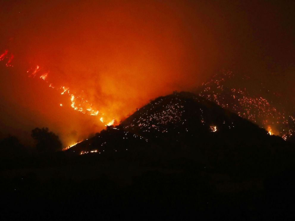 PHOTO: The Thomas Fire burns in the mountains, Dec. 6, 2017, near Ojai, Calif.