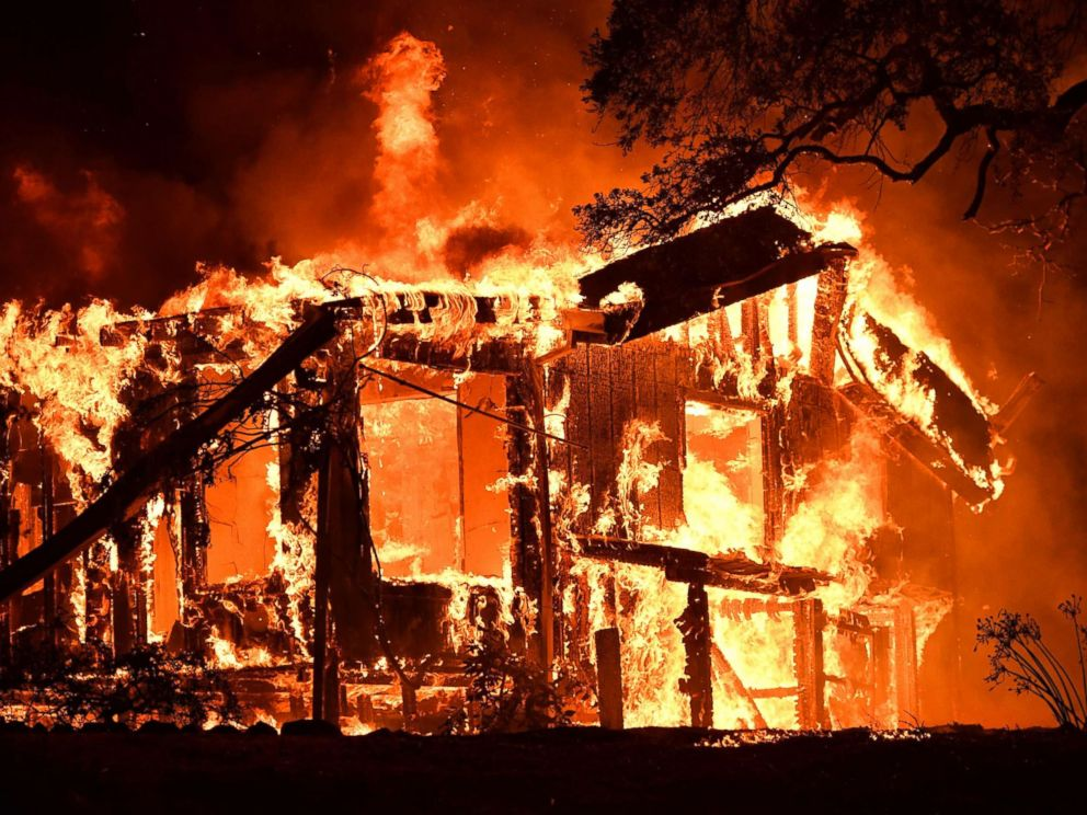 PHOTO: Flames ravage a home in the Napa wine region in California, Oct. 9, 2017, as multiple wind-driven fires continue to whip through the region.