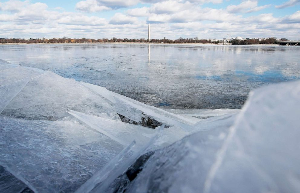 PHOTO: The Washington Monument stands in the distance, reflected in the frozen Potomac River, Jan. 1, 2018, from Arlington, Va.