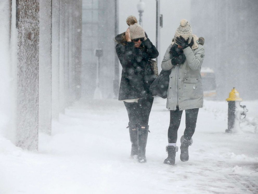 PHOTO: Two women struggle to walk in the blowing snow during a winter storm, March 14, 2017, in Boston.