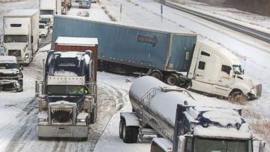 'PHOTO: Two tractor trailers collided in snowy conditions, Dec. 12, 2017, in Granger, Ind.' from the web at 'http://a.abcnews.com/images/US/winter-weather-indiana-ap-mem-171213_16x9t_384.jpg'