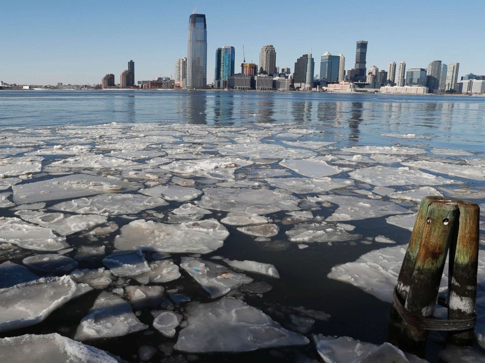 PHOTO: Ice floats in the Hudson River in Lower Manhattan with Jersery City, N.J., visible across the river, Jan. 7, 2018, as bitterly cold temperatures continued through the weekend in New York.
