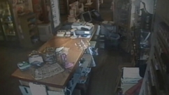 Old country stores surveillance video shows the top of a glass dish seemingly move on its own.