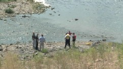 VIDEO: Witnesses and police thought sleeping swimmer was a dead body floating in the shallow water.