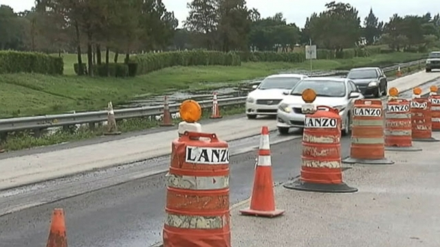 Archaeologists unearth womans bones discovered by crews doing road work in Davie, Fla.