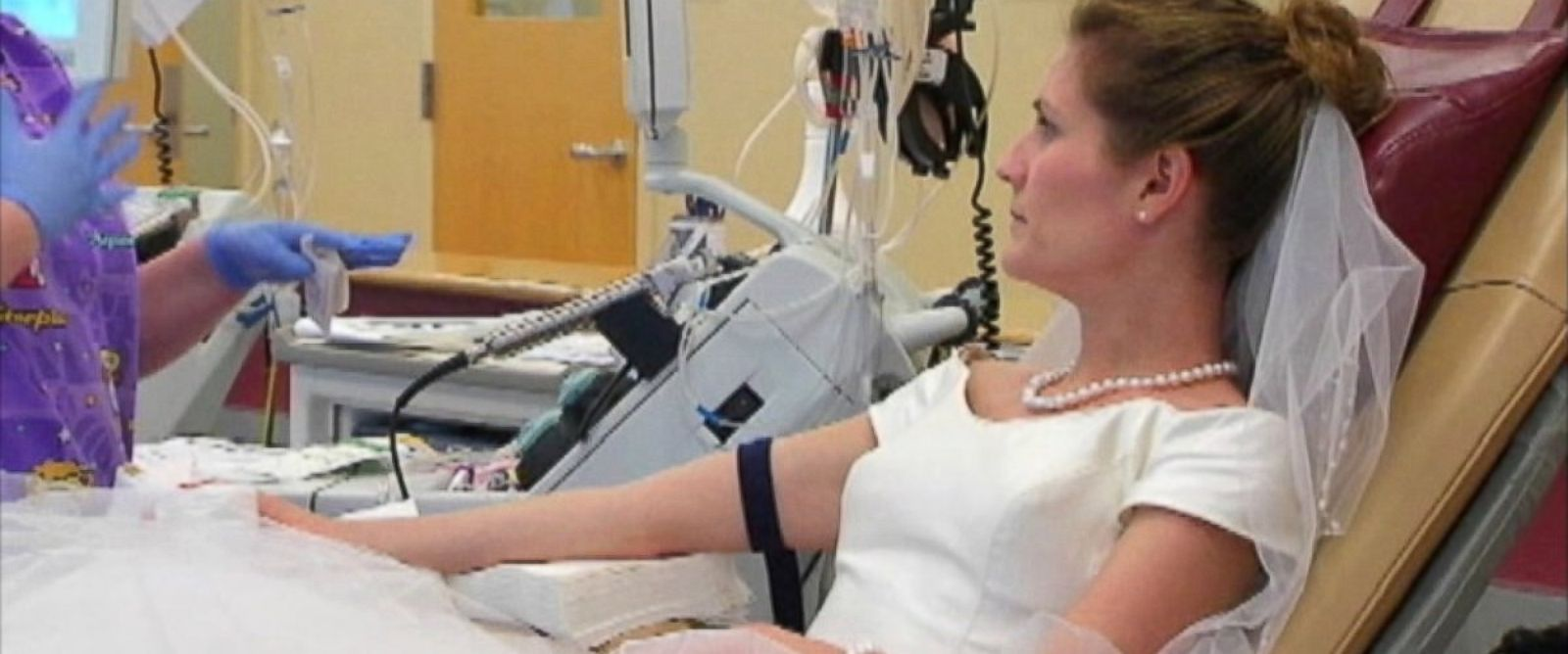 PHOTO: Monica Behney donates blood on her wedding day at the Virginia Blood Services Donor Center in Richmond, Virginia on June 1, 2014.
