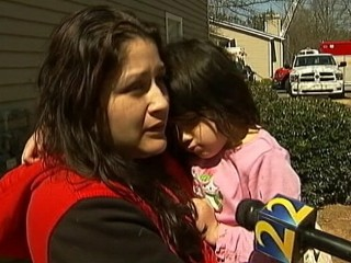 Watch: Child Thrown Out Window, Mom Safely Flees Fire
