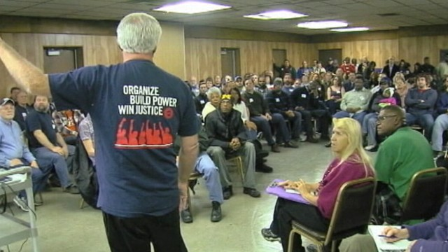 VIDEO: United Auto Workers gather for civil disobedience training in preparation for protests.