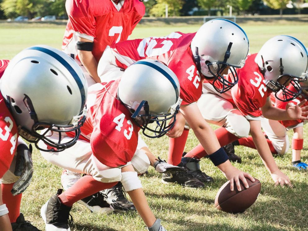 PHOTO: Football players get ready at line of scrimmage in this undated stock image.