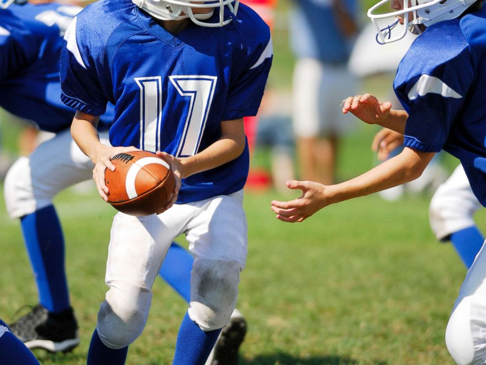 PHOTO: A young football player passes a ball in this undated stock image.