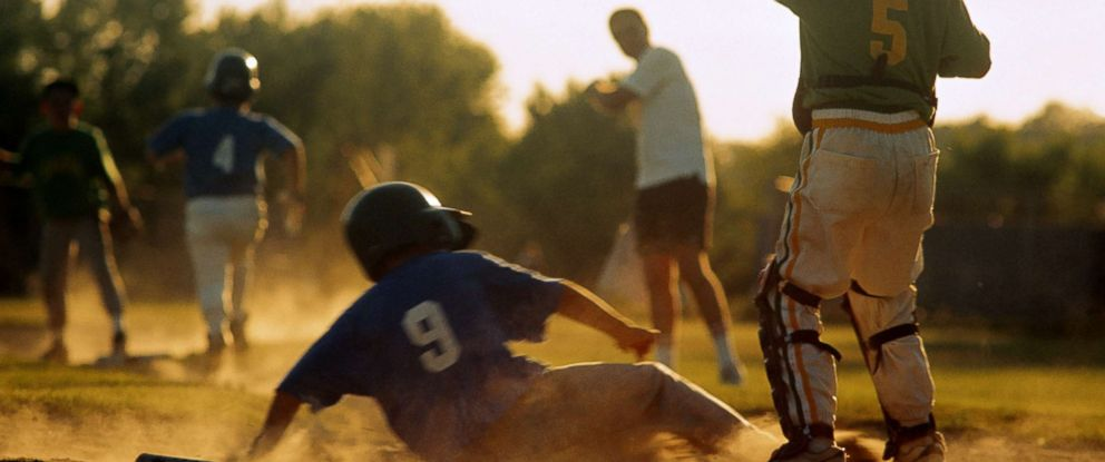 PHOTO: Young children play baseball.