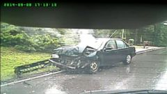 VIDEO: A driver is involved in two collisions on a rainy day, both caught on video.