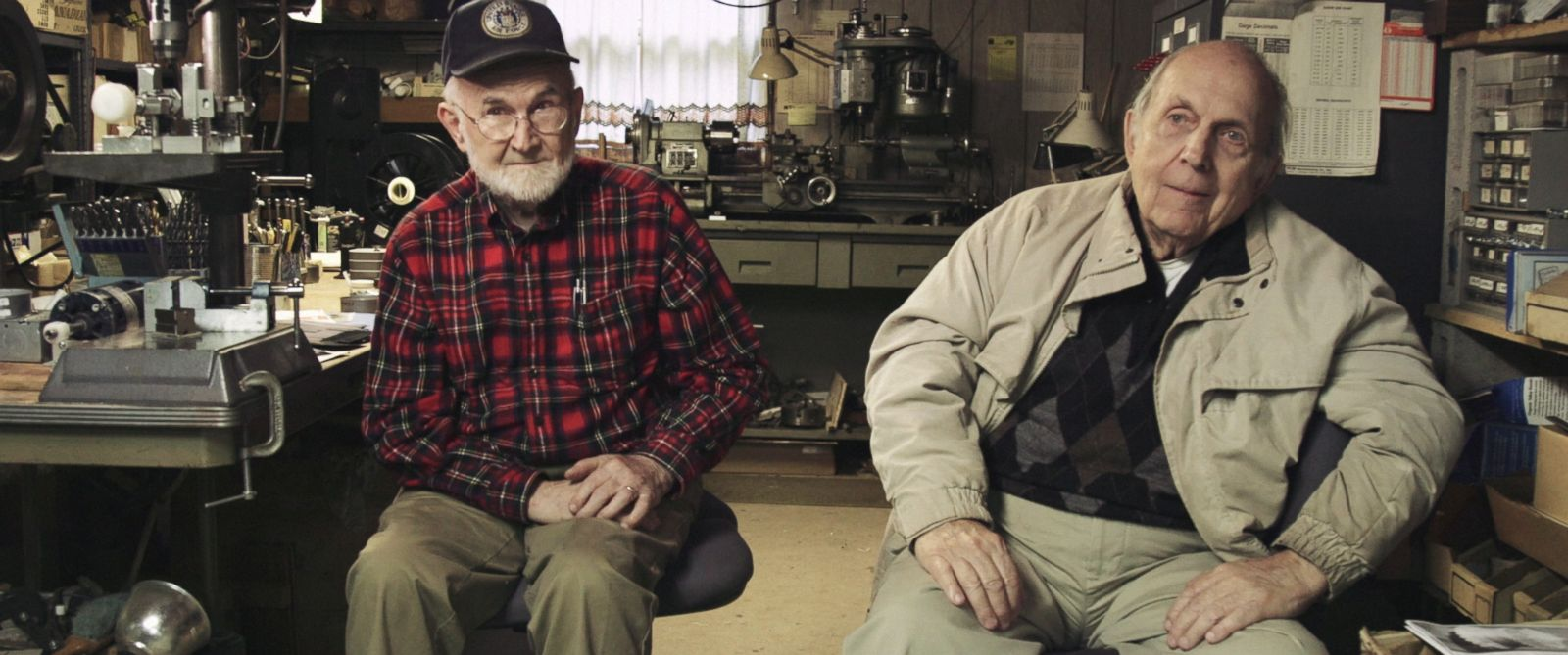 PHOTO:Robert Nepper and Bill Stevenson sit in their basement workshop in St. Paul, MN.