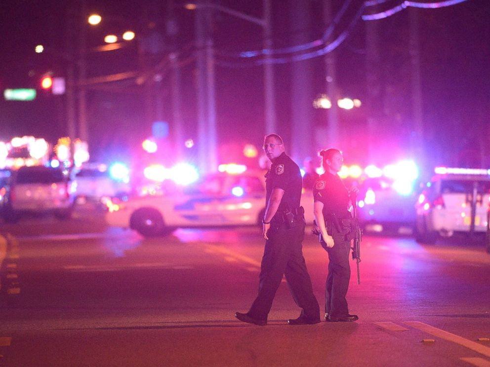 PHOTO: Police officers stand guard down the street from the scene of a shooting involving multiple fatalities at a nightclub in Orlando, Fla., June 12, 2016.