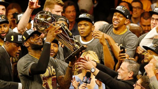 PHOTO: Cleveland Cavaliers forward LeBron James hoists the Larry O'Brien trophy after defeating the Golden State Warriors to win the NBA Finals, June 19, 2016, in Oakland, Calif.