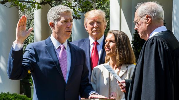PHOTO: Justice Anthony M. Kennedy, right, administers the judicial oath to Neil M. Gorsuch, while President Donald J. Trump and Gorsuch's wife Louise look on, in the Rose Garden of the White House in Washington, April 10, 2017.