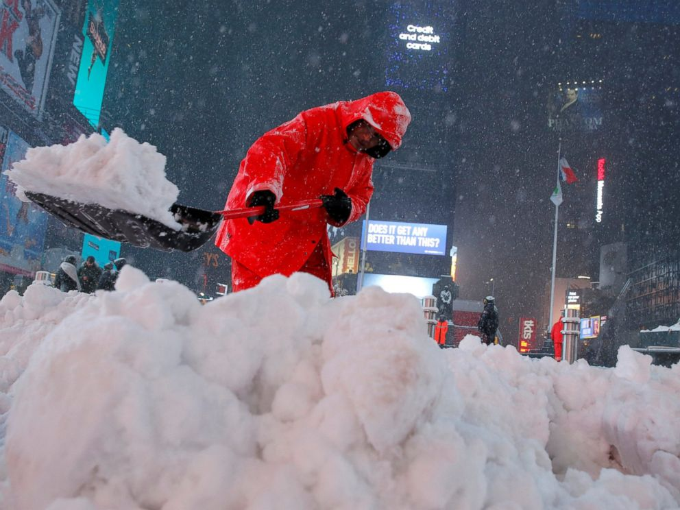 PHOTO: A worker clears snow in Times Square as snow falls in Manhattan, N.Y., March 14, 2017.