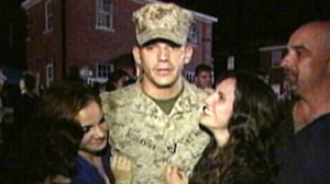 Photo: Soldier Reunited With His Family After Surviving Afghan Tour: U.S. Marine fulfills his World News wish to hug his sisters upon his arrival