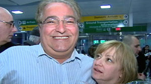 Anthony Naimoli is greeted by his wife, Randi, at John F. Kennedy Airport in New York, after returning from Haiti, where he had been missing for days after the earthquake.