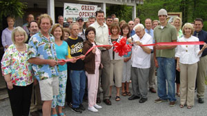 PHOTO Forrest Graves, center, with sunglasses, at the opening of his family-run business, JumpinGoat Coffee, in Helen, Ga.