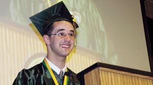 PHOTO Eric Duquette delivers his graduation speech to classmates from Smithfield High School in Rhode Island.