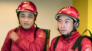 PHOTO Two McDonald?s delivery workers are shown in Shanghai, China, Nov. 15, 2010.