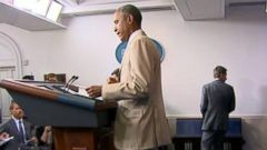 VIDEO: President Obama gets flak for wearing a beige suit during a press briefing.