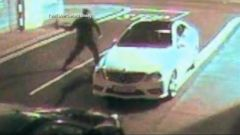 VIDEO: A thief attempts to break into a car with a brick, but ends up knocked out cold.